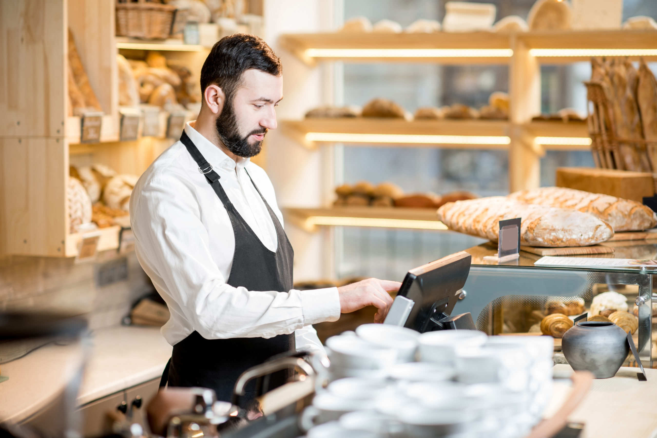 Imagefoto Bäcker und elektronische Kasse
